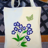 Hand Painted Tote Bag With Blue Flowers And A Butterfly Charm