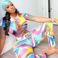 2020 new women's printed cropped navel cutout rope casual jumpsuit