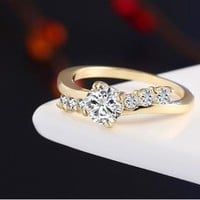 Elegant Round CZ Diamond Ring - Surrounded by Small Inlaid CZ's
