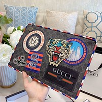 GUCCI new men and women wild canvas embroidery logo clutch bag wash bag