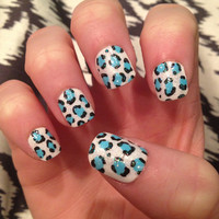 Turquoise and glitter leopard print design on false nails