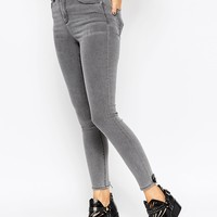 ASOS Ridley Skinny Ankle Grazer Jeans In Murray Wash With Punctured Hem at asos.com