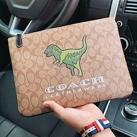 COACH New fashion pattern dinosaur print leather cosmetic bag handbag file package