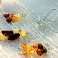 Adult Baltic Amber Dangle Earrings 8 Piece Set. Made with 100% Baltic polished amber, mixed colors.