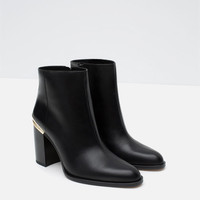 HIGH HEEL LEATHER ANKLE BOOTS WITH METALLIC DETAIL