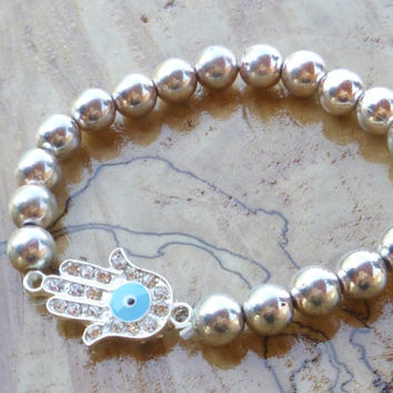 Silver beaded bracelet with Hamsa good luck charm