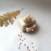 Miniature cabinet with a cute little bird wood carving by plad