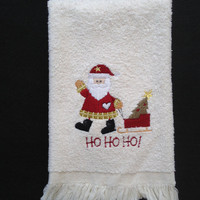 Santa Waving,  Pulling a Sleigh With a Tree and HO HO HO Embroidered on a Christmas Tea Towel