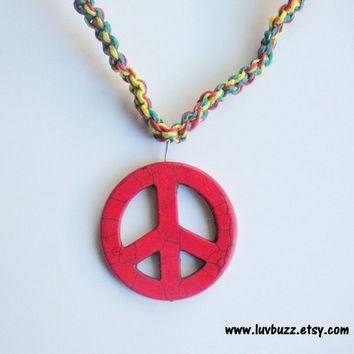 Large red peace sign macrame hemp necklace in Rasta shades.