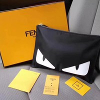 FENDI CANVAS AND LEATHER ZIPPER HAND BAG