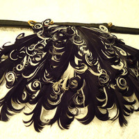 Couture dog collar with superior quality soft leather and curled feather drop.