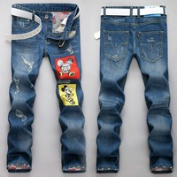 Ripped Holes Strong Character Print Slim Jeans [6541761603]