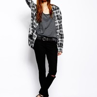 ASOS Whitby Low Rise Skinny Ankle Grazer Jeans in Clean Black with Rip