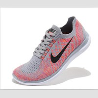NIKE casual lightweight knitted running shoes Gray pink