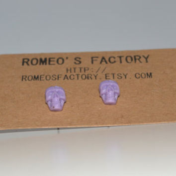 Lilac skull earrings
