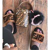 SANDALS Brown leather and sheepskin slides