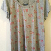 grey shirt with cat stamps