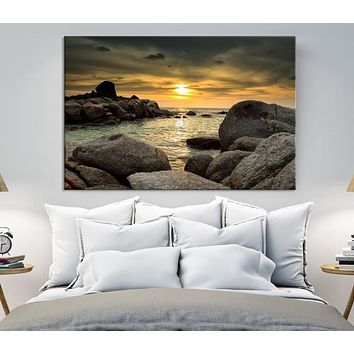 Big Stones on Beach with the Sunset Canvas Print