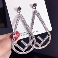 Fendi Women Fashion New Letter More Diamond Personality Long Earring Eardrop Accessories Silver