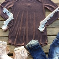 Mocha color long sleeve shirt with white lave down the sleeves.
