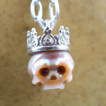 Hand Carved Pink Pearl Skull Wearing Sterling Silver Crown Necklace