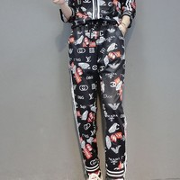 """""""LOUIS VUITTON"""" Woman's Leisure  Fashion Letter Personality Printing Short Sleeve Trousers Two-Piece Set"""