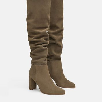 HIGH HEELED LEATHER BOOTS DETAILS