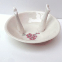 place this small dish by your bedside table for rings, in your bathroom for soap, or on your coffee table for incense or a candle. you may even want to use it in your kitchen (it's glazed inside) for butter or salt. so versatile!