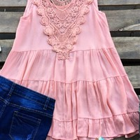Our Baby Don't Lie Tunic Top - Peach is so cute! It is a sleeveless tunic top with tiered ruffles and crochet insert located on the back. It is not lined so consider wearing a cami underneath.