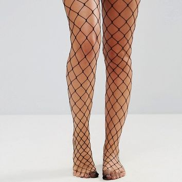 ASOS 2 Pack Oversized Fishnet Tights In Black And White at asos.com