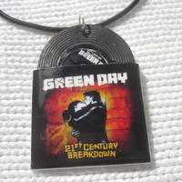 Green Day vinyl record miniature charm on black rubber necklace