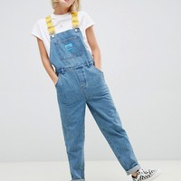 The Simpsons x ASOS DESIGN denim overalls with taping at asos.com