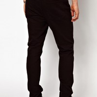 Cheap Monday | Cheap Monday Jeans Dropped Tapered Fit In New Black at ASOS