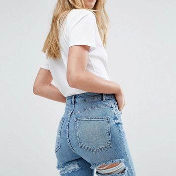ASOS FARLEIGH High Waisted Slim Mom Jeans in Prince Wash with Bum Rips at asos.com