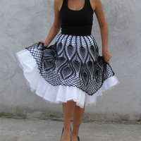 Uniquehttp://www.etsy.com/listing/75662920/unique-tutu-crochet-skirt-black-and?ref=v1_other_2 by kovale