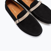 Leather moccasin with ribbon