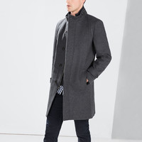 Grey coat with knit collar
