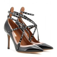 Love Latch patent leather pumps