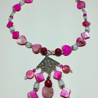Necklace with Pendant. Pink Mother of Pearl shell beads with moonstone beads and Multi-faceted Crystal beads. With a unique Pendant.