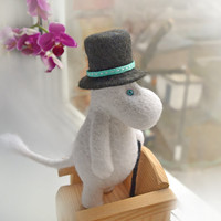 Moominpappa is the patriarch of Moomin family, great traveler and writer. The funny snow white felting doll of Moominvalley's inhabitant.