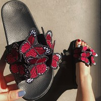 Embroidered butterfly slippers