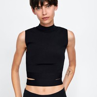 FUNNEL NECK TOP WITH CUT OUTS DETAILS