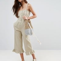 ASOS Cami Jumpsuit with Frill Hem and Button Front at asos.com