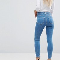 ASOS DESIGN Petite Ridley high waist skinny jeans in light wash at asos.com