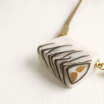 Bioresin and pinecone necklace, brown cord