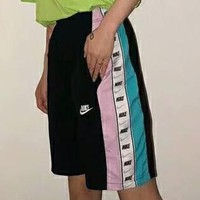NIKE new fashion summer string mark print side embroidery letter hook women and men splice loose leisure shorts
