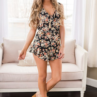 Wonder About Us Sleeveless Ruffle Hemline Tie Chest Floral Romper (Black)