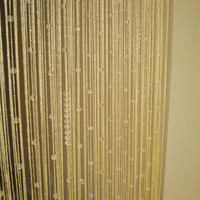 Golden-tone beaded curtain