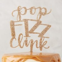 Alexis Mattox Design New Year's Cake Topper in Gold Size: One Size Sweaters