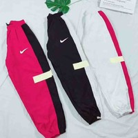 NIKE New fashion women and men reflective pants three color red black white